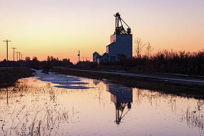 Photograph - Classic Wooden Grain Elevator Reflection at Sunrise by Steve Boyko