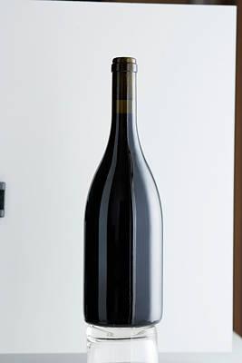 Photograph - Close Up Of Bottle Of Bordeaux Wine by Brett Stevens