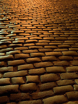 Photograph - Close-up Of Cobblestone Street At Night by Jeff Spielman