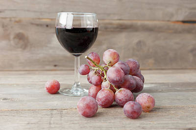 Photograph - Close Up Of Grapes And Glass Of Wine by Stefanie Grewel