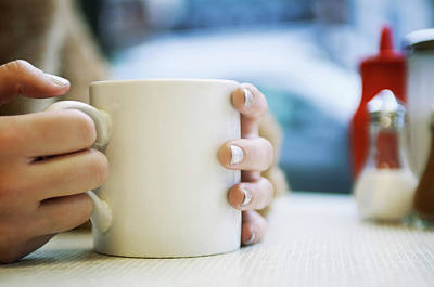 Photograph - Close Up Of Hands Holding Cup Of Coffee by Tara Moore