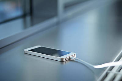 Close-up Of Smartphone Charging Art Print by Klaus Vedfelt