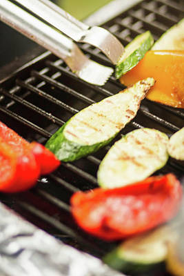 Zucchini Photograph - Close Up Of Vegetables Cooking On Grill by Manuel Sulzer