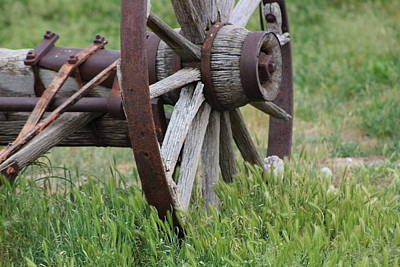 Photograph - Closeup Vintage Wooden Wagon Wheel In Grass by Colleen Cornelius