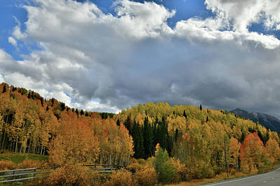 Photograph - Clouds Pass Over Hills Of Colorful Aspens by Ray Mathis