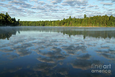 Photograph - Clouds Reflected In A Calm Lake by Kevin McCarthy