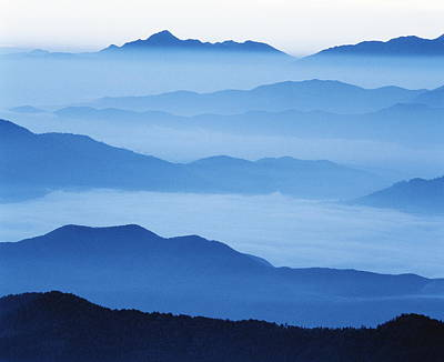 Photograph - Clouds Shrouding A Mountain Range by Gyro Photography/amanaimagesrf