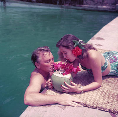 Drinking Photograph - Coconut Cocktail by Slim Aarons