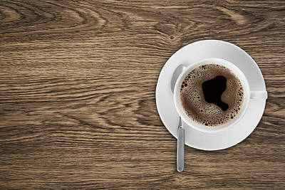 Photograph - Coffeecup With Coffee In It On A Wooden by Daneger