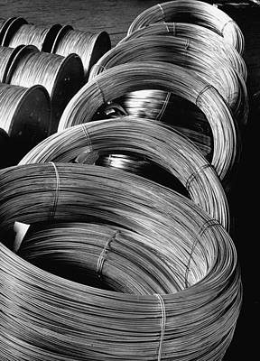 Photograph - Coiled Rod Ready To Draw Into Wire At Al by Margaret Bourke-white