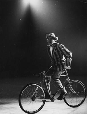 Photograph - Comic Cyclist by Thurston Hopkins