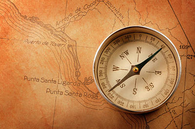 Topography Wall Art - Photograph - Compass On Old Antique Rusty Colored Map by Dny59