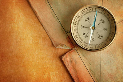 Topography Wall Art - Photograph - Compass On Old Map by Dny59