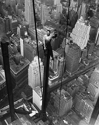 Photograph - Construction Worker Waves From Empire by Bettmann