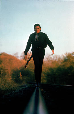 Photograph - Country Music Star Johnny Cash Walking by Michael Rougier