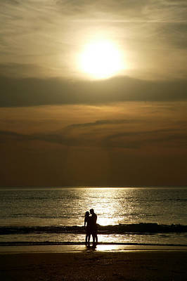 Photograph - Couple At Sunset On Beach by Jezphotos
