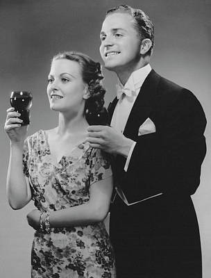 Photograph - Couple Dressed Up Holding Drinks by George Marks