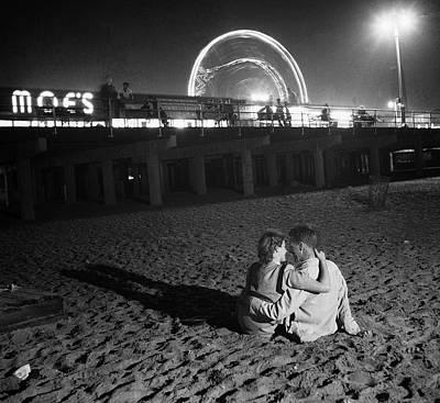 Photograph - Couple Embracing On Coney Island Beach by Bettmann
