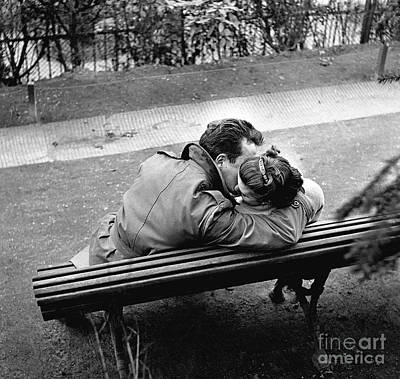 Photograph - Couple Of Lovers Kissing On A Bench At The Pere Lachaise, Paris, 1955 by Gerald Bloncourt