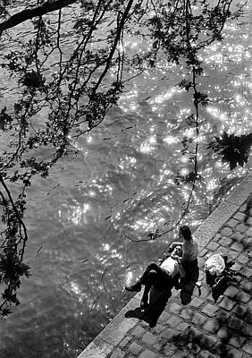 Couple Photograph - Couple Relaxing On Bank Of Seine Near No by Alfred Eisenstaedt