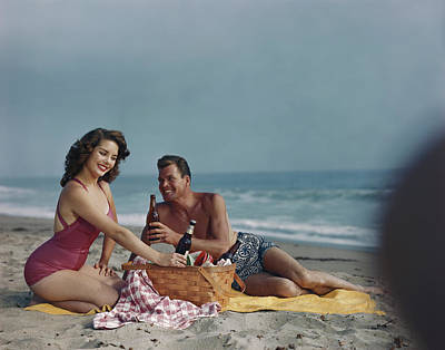 Photograph - Couple Sitting On Beach Holding Beer by Tom Kelley Archive