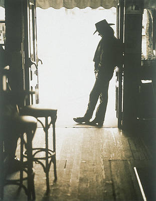 Pub Photograph - Cowboy Leaning In Doorway by John Halpern