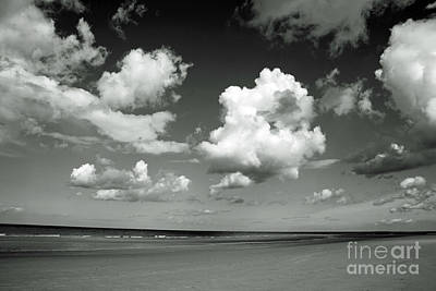 Minimalist Movie Quotes - Cumulus clouds passing across the beach at Holkham Norfolk England by Michael Walters