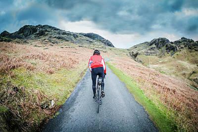 Ambleside Wall Art - Photograph - Cycling Up The Hardknott Pass by Steve Fleming