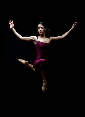 Hand Photograph - Dancer Posing In Mid Air by David Sacks