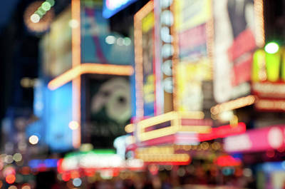 Photograph - Defocused Bright Lights Of Time Square by Travelif