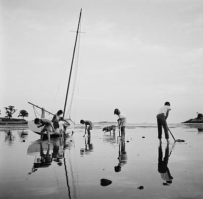 Beach Photograph - Digging For Clams by Slim Aarons