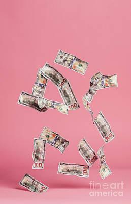 Photograph - Dollar Bills Falling Down On Pink Background. by Michal Bednarek