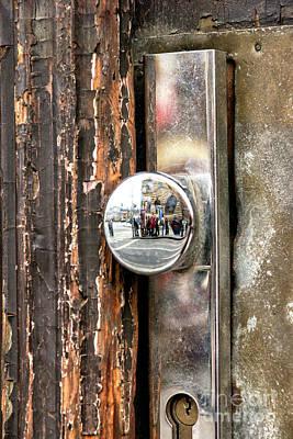 Photograph - Door Reflections In Prague by John Rizzuto