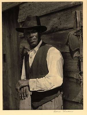 Bath Time Rights Managed Images - Doris Ulmann   1882-1934 , Bearded black man in hat and vest, standing with hands on post, in front  Royalty-Free Image by Doris Ulmann