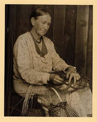 Fall Animals - Doris Ulmann   1882-1934  Elderly woman in dress and necklace, seated in chair, making basket with  by Doris Ulmann