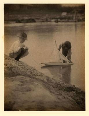Winter Animals Rights Managed Images - Doris Ulmann   1882-1934  The New Boat 1918 Boy in hat squatting on bank, with boy in water holding Royalty-Free Image by Doris Ulmann