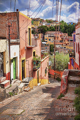 Photograph - Downhill Narrow Street In Guanajuato, Mexico by Tatiana Travelways
