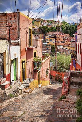 Photograph - Downhill Narrow Street In Guanajuato, Mexico by Tatiana Travelways