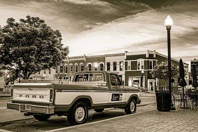 Photograph - Downtown Bentonville Arkansas Square Skyline And Sam Walton Walmart Museum Truck - Sepia by Gregory Ballos