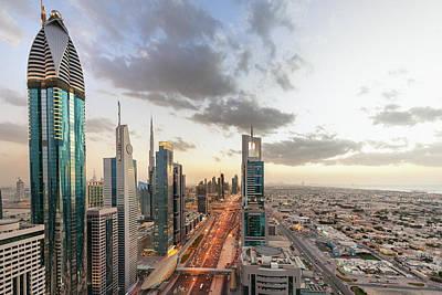 Photograph - Dubai At Sunset by Pidjoe