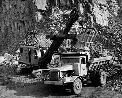 Open Photograph - Earth Mover Loading Rocks In To A Dump by Superstock