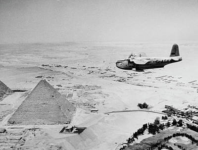 Flying Photograph - Egypt, Giza, Airplane Flying Over Giza by Superstock