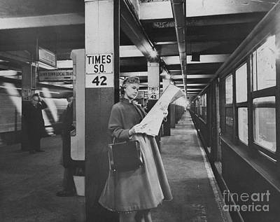 Photograph - Elise Rhodes Reads Her Daily Newspaper by New York Daily News Archive