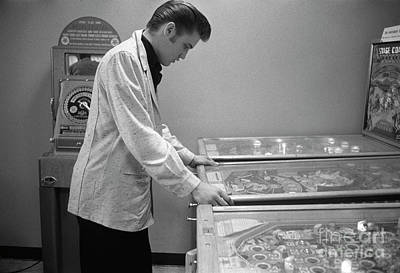 Music Royalty-Free and Rights-Managed Images - Elvis Presley playing pinball 1956 by The Harrington Collection