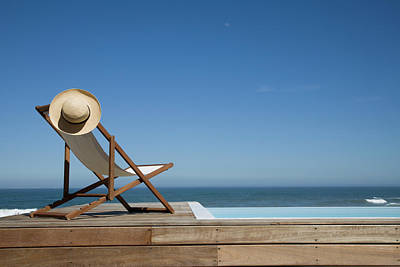 Lounge Chair Photograph - Empty Deck Chair Near Swimming Pool by Altrendo Images