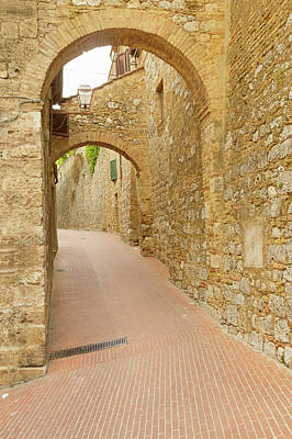 Landscapes Royalty-Free and Rights-Managed Images - Empty street with stone arches in San Gimignano. Italy.  by Jaroslav Frank