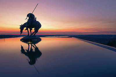 Landmarks Royalty Free Images - End of the Trail Statue Silhouette - Top of the Rock Sunset Reflections Royalty-Free Image by Gregory Ballos