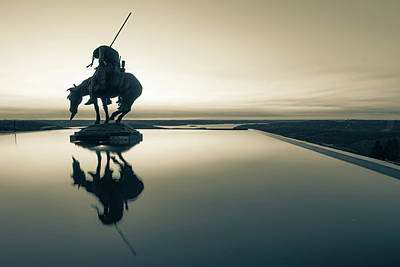 Landmarks Royalty Free Images - End of the Trail Statue Silhouette - Top of the Rock Sunset Reflections in Sepia Royalty-Free Image by Gregory Ballos