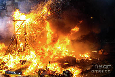 Photograph - End Of The Valencian Festivities Of Fallas, Monument Faller Consumed In The Fire In High Flares. by Joaquin Corbalan