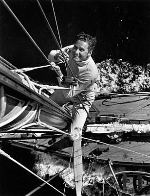 Photograph - Errol Flynn Climbs The Mast by Peter Stackpole